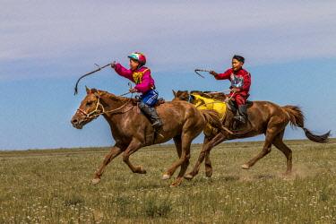 AS25TNO0036 Horseback Riders. Kids competition. Naadam Festival. Gobi Desert. Mongolia.