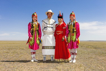 AS25TNO0087 Entertainers in local dress. Naadam Festival. Gobi Desert. Mongolia.