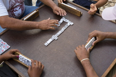 CA11BTH0174 Cuba, Trinidad. Men playing dominoes outdoors.