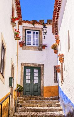 EU23WPE0023 Narrow White Street 11th Century Medieval Town, Obidos, Portugal.