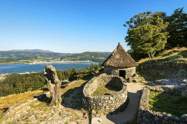 POR9629AW Castro de Santa Tecla (Castro de Santa Trega in galician), dating back to the 1st century B.C.. Portugal on the background. Galicia, Spain