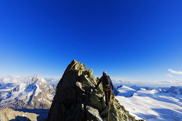 SWI7968 Western Europe, Switzerland, Swiss Alps, Valais, climber on south ridge of Dent Blanche (4357m) with view to the Matterhorn, MR