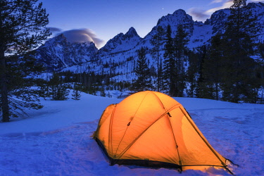 US51RBS0018 Winter camp at dusk under the Tetons, Grand Teton National Park, Wyoming, USA