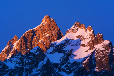 US51RBS0030 Dawn light on the Grand Teton and Mount Owen in winter, Grand Teton National Park, Wyoming, USA