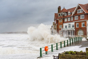 ENG14877AW United Kingdom, England, North Yorkshire, Sandsend. Rough seas during a January storm surge outside the Sandsend Hotel.