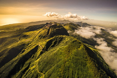 French West Indies, Guadeloupe, Basse Terre, Saint Claude, South North summit free of La Soufriere, L'echelle and all the volcanic chain, visible together only a few days a year, here overlooking La C...