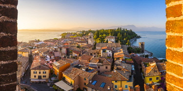 ITA11227AW Sirmione, lake Garda, Brescia province, Lombardy, Italy. High angle view of the old town at sunset.