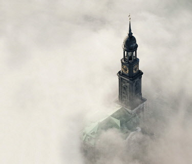 "IBLHWE03580859 Aerial view, tower of the church of St. Michaelis or ""Michel"" in the fog, Hamburg, Germany, Europe"