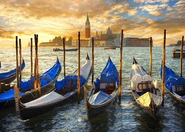 IBLPWN03734604 Gondolas at St Mark's Square with the island of San Giorgio Maggiore at the back, at sunset, Venice, Veneto, Italy, Europe