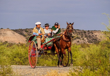 ARG2556AW Gauchos on the horse carriage, Vallecito, San Juan Province, Argentina
