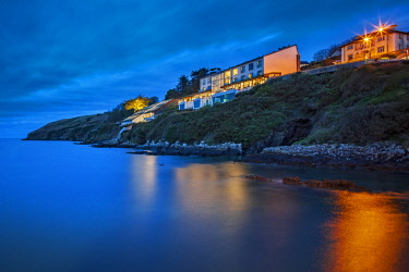 IRL0647 The 5 Star Cliff House Hotel overlooking the Celtic Sea Coastline at twilight, Dysert, Ardmore, Co. Waterford, Ireland.