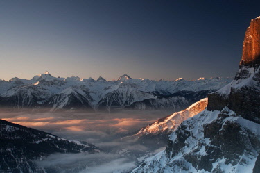 IBLFOX03872651 View from Gemmi Pass to Leukerbad and the Pennine Alps with Mt Matterhorn at sunset, Canton of Valais, Switzerland, Europe