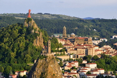 HMS2570083 France, Haute Loire, Le Puy en Velay, a stop on el Camino de Santiago listed as World Heritage by UNESCO, overview of the city with Notre Dame de France statue (1860) at the top of on Rocher Corneille...