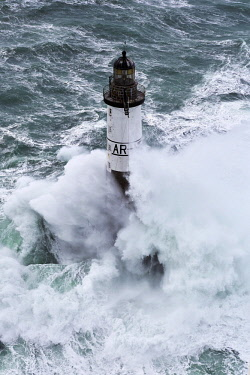 HMS1884208 France, Finistere, Iroise Sea, Iles du Ponant, Parc Naturel Regional d'Armorique (Armorica Regional Natural Park), Ile de Sein, Chaussee de Sein, Ar Men Lighthouse during storm Ruth, February 8th 2014...