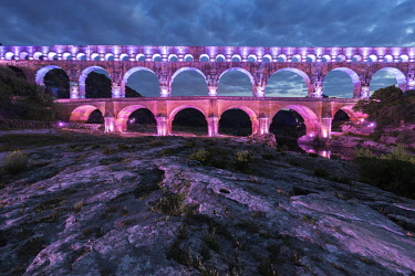 HMS2234387 France, Gard, the Pont du Gard listed as World Heritage by UNESCO, Big Site of France, Roman aqueduct from the 1st century which steps over the Gardon, design light Guillaume Sarrouy