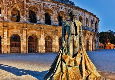 HMS3085124 France, Gard, Nimes, Arenas, quare of the Roman amphitheater Nimes with the statue of a matador Nimeno II