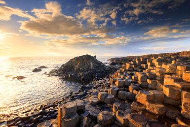NIR8902AW Europe, Northern Ireland, Giant's Causeway at sunset