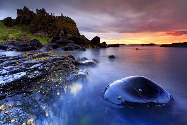 NIR8911AW Europe, Northern Ireland Dunluce Castle at sunset