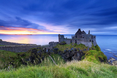 NIR8913AW Europe, Northern Ireland, Dunluce Castle at sunset