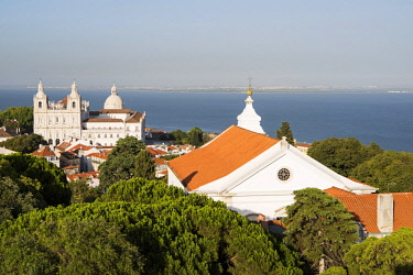 POR9479 Portugal, Lisbon, The Alfama.  View over the trees and roofs of Alfama to the church of Sao Vicente de Fora and the dome of Santa Engracia.