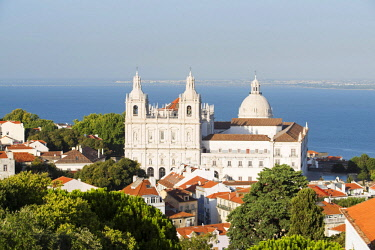 POR9480 Portugal, Lisbon, The Alfama.  View over the trees and roofs of Alfama to the church of Sao Vicente de Fora and the dome of Santa Engracia.