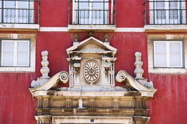 POR9579 Portugal, Lisbon, The Alfama.  Ornate carving above a doorway on a mansion.