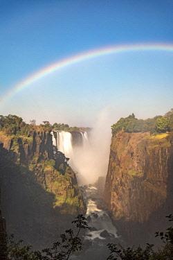 ZIM2544AWRF Victoria Falls, Zimbabwe, Africa. Rainbow and water steam