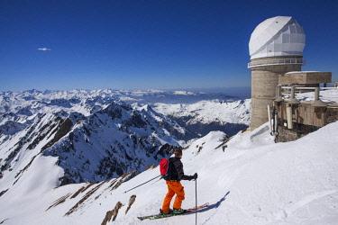 HMS1904587 France, Hautes Pyrenees, Bagneres de Bigorre, La Mongie, Pic du Midi de Bigorre (2877m), skier on the first slopes of the Pic du Midi, in the background, the dome of the telescope Bernard Lyot