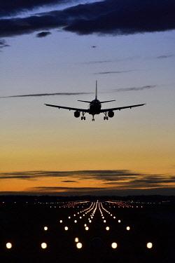 IBXATF04070104 Aircraft landing at sunset at Munich Airport Franz Josef Strauss, Munich, Upper Bavaria, Bavaria, Germany, Europe