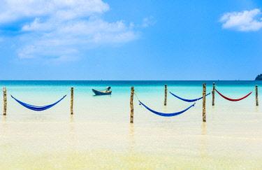 IBXVFW04406603 Motorboat, hammocks on idyllic sandy beach, turquoise sea, Saracen Bay, Koh Rong Samloem island, Krong Preah Sihanouk, Sihanoukville, Cambodia, Asia