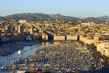 HMS2062693 France, Bouches du Rhone, Marseille, Euromediterranean area, Vieux Port, crowd on the pier Rive Neuve on national day, Massif du Garlaban in the background