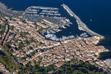 HMS3093620 France, Var, Gulf of Saint Tropez, Saint Tropez peninsula, Saint Tropez village, port, luxury yacht (aerial view)