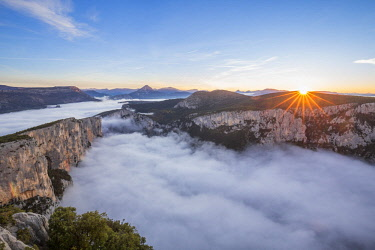HMS2688693 France, Alpes de Haute-Provence, regional natural reserve of Verdon, Grand Canyon of Verdon, cliffs of the Barres of Escalès seen by the belvedere of the Dent d'Aire, morning autumn fogs