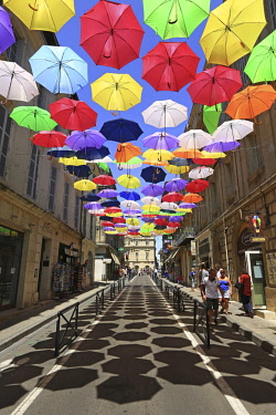 HMS2482746 France, Bouches du Rhone, Arles, Jean Jaures street, installation of Patricia Cunha Colorful Umbrellas (Compulsory Mention)