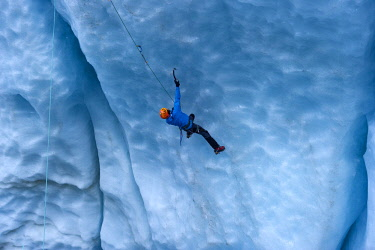 HMS2450029 France, Haute Savoie, Chamonix, Ice Sea, young man ice climbing in the mills of the Mer de Glace