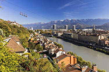 HMS2690847 France, Isere, Grenoble, view of Grenoble-Bastille cable car and its Bubbles, the oldest city cable car in the world, view of the 13th century Saint Andre church and Belledonne massif