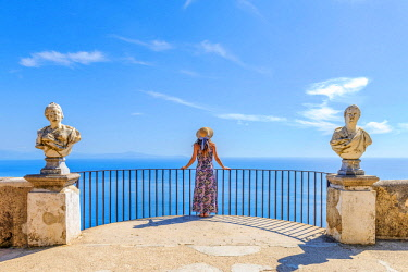 Villa Cimbrone, Ravello, Amalfi coast, Salerno, Campania, Italy. Girl admiring the view from the Terrace of Infinity (MR)