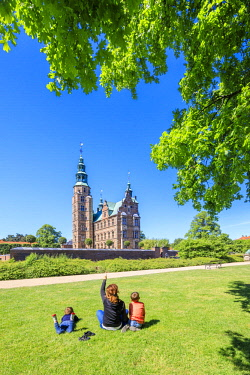 CLKRM65324 Mother and sons look the Rosenborg Castle from the gardens, Copenhagen, Denmark