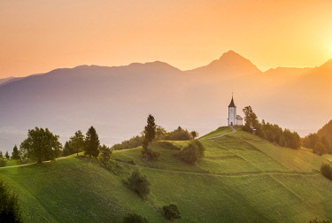 CLKST67332 The iconic Jamik church, with Mount Triglav on the background. Jamnik, Kranj, Upper Carniola, Slovenia.