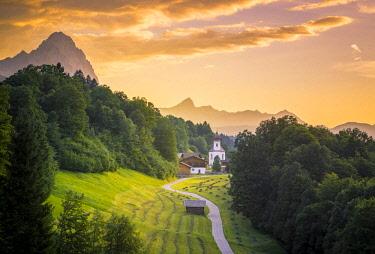 CLKST68687 The iconic Wamberg Church, with Mount Alpspitze and Zugspitze on the background. Wamberg, Garmisch Partenkirchen, Bayern, Germany