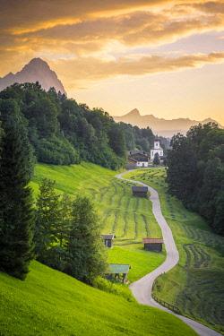 CLKST68691 The iconic Wamberg Church, with Mount Alpspitze and Zugspitze on the background. Wamberg, Garmisch Partenkirchen, Bayern, Germany