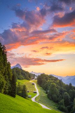 CLKST68692 The iconic Wamberg Church, with Mount Alpspitze and Zugspitze on the background. Wamberg, Garmisch Partenkirchen, Bayern, Germany