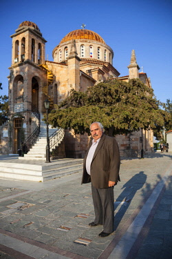 GRE1445 Greece. Athens. Vilia. Elderly Greek man in front of the Greek Orthodox Church in the town of Vilia in the suburbs of Athens.
