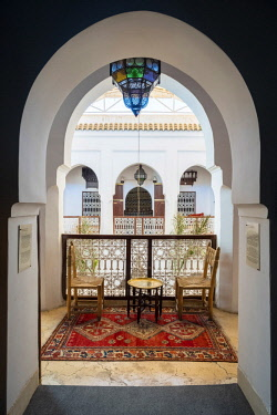 MOR2364AW Morocco, Marrakech-Safi (Marrakesh-Tensift-El Haouz) region, Marrakesh. Table and chairs for serving tea at the Heritage Museum, housed in a restored historic riad.