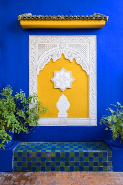 MOR2379AW Morocco, Marrakech-Safi (Marrakesh-Tensift-El Haouz) region, Marrakesh. Decorative architectural elements and blue wall at Jardin Majorelle gardens.
