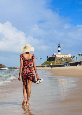 BRA3493AW Brazilian Model walking on the Farol da Barra Beach, Salvador, State of Bahia, Brazil (MR)