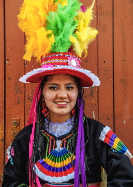 PER34146AW Girl in traditional clothing, Fiesta de la Virgen de la Candelaria, Puno, Peru