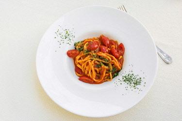 ITA11117AW Europe, Italy, Umbria, Spoleto. Pasta with freh tomato sauce.