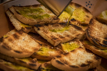 ITA11131AW europe, italy, umbria. toasted bread with olive oil.