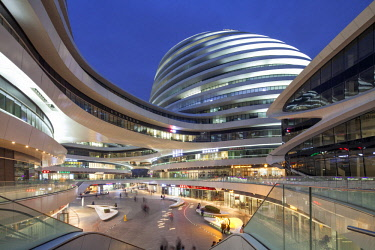 CH1395 The Galaxy Soho building comprises four main domed structures, fused together by bridges and platforms between curving floor plates to create a fluid environment that surrounds a series of public cour...